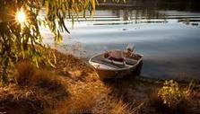 Riverina classic fishing boat riverbank