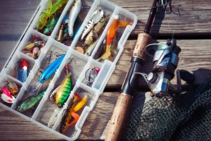 Fishing Lures In Tackle Boxes With Spinning Rod And Net